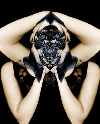 A woman mirrored into herself, dark, creepy and unsettling. Shows the distortion of reality.