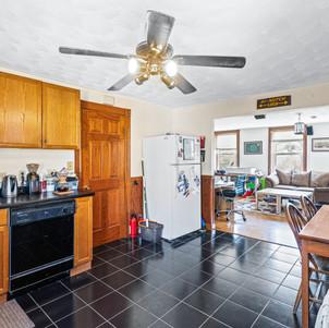 Kitchen with black tile floor