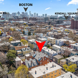 Spring Street drone photo with view of Kendall Square and Boston skyline