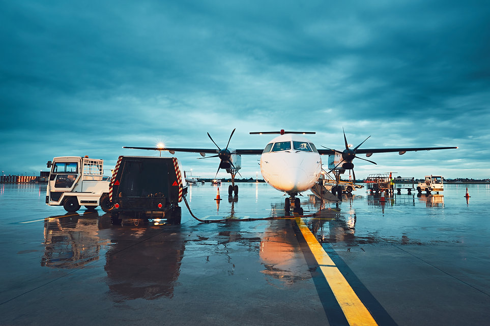 a-busy-airport-in-the-rain-PVZ6MBM.jpg