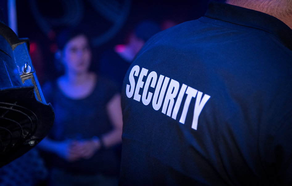 Back of a bouncer (security guard) in a