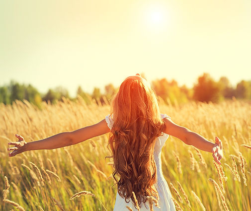 Girl-long-hair-field-sun-shutterstock_40