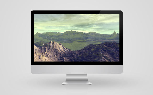 a desktop Mac computer with a landscape photograph on the screen