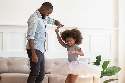 Loving black dad holding hand of child d