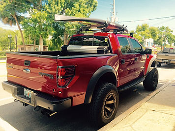 Truck with Thule roof rack and paddleboard