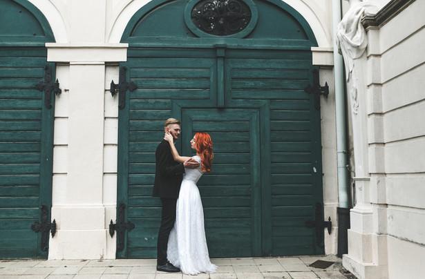 couple in front of wooden doors
