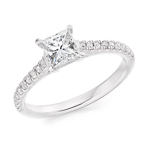 Princess cut solitaire ring with diamond shoulders