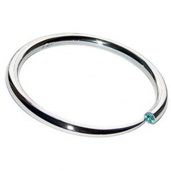 Wiggly silver tapering bangle with topaz