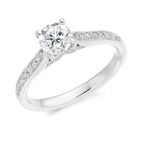 Round brilliant solitaire with diamond shoulders and mount