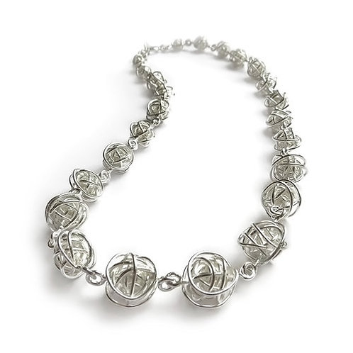 Tapering silver balls necklace