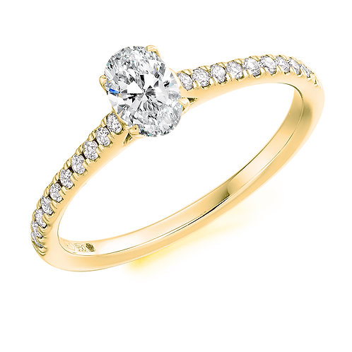 Oval diamond ring with diamond shoulders.