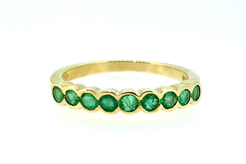 Emerald and Gold Eternity ring