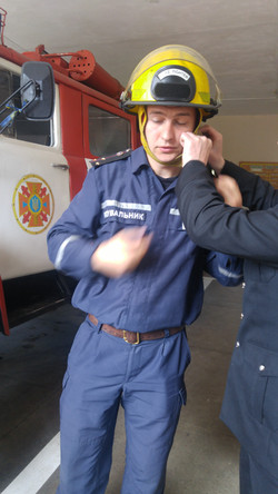 firefighter trying helmet