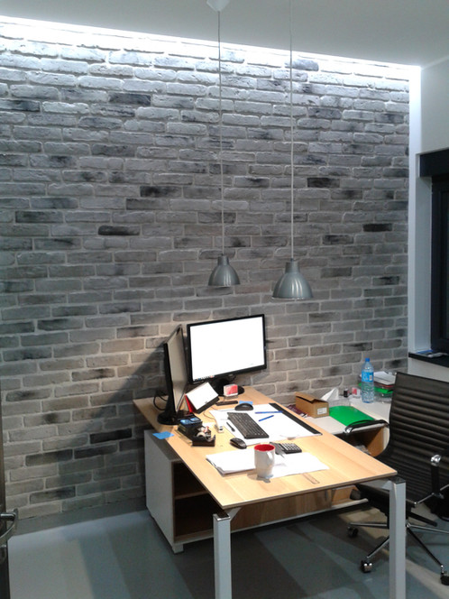 the old grey brick feature wall tile has a feel and the light colour creates a softer look