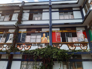 Facade of School Building with depiction of the train carrying World famous personalities from India