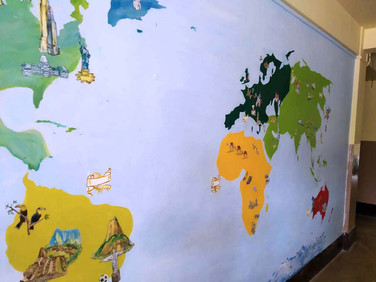 Educative world map painted at the school entrance