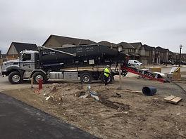 Black large truck working