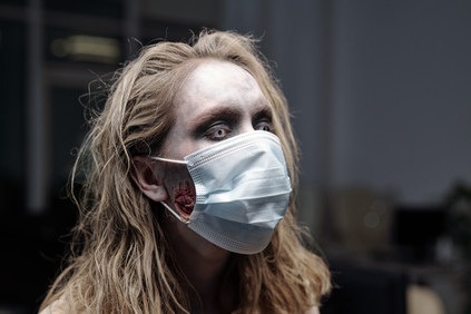 female-zombie-protective-mask-standing-front-camera-office.jpg
