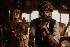 man-engineers-steampunk-suit-with-top-hat-with-glasses-gas-mask.jpg