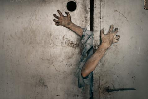 zombie-hands-sticking-out-elevator-door.jpg