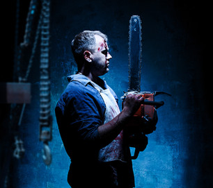 bloody-halloween-theme-crazy-killer-as-bloody-butcher-with-electric-saw-dark-blue-backgrou