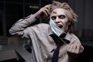 scary-zombie-businessman-holding-surgical-mask-by-his-face.jpg