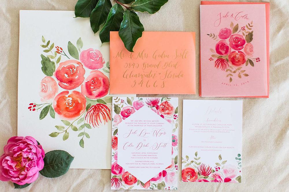 Custom pink, coral and orange floral watercolor wedding invitation suite.