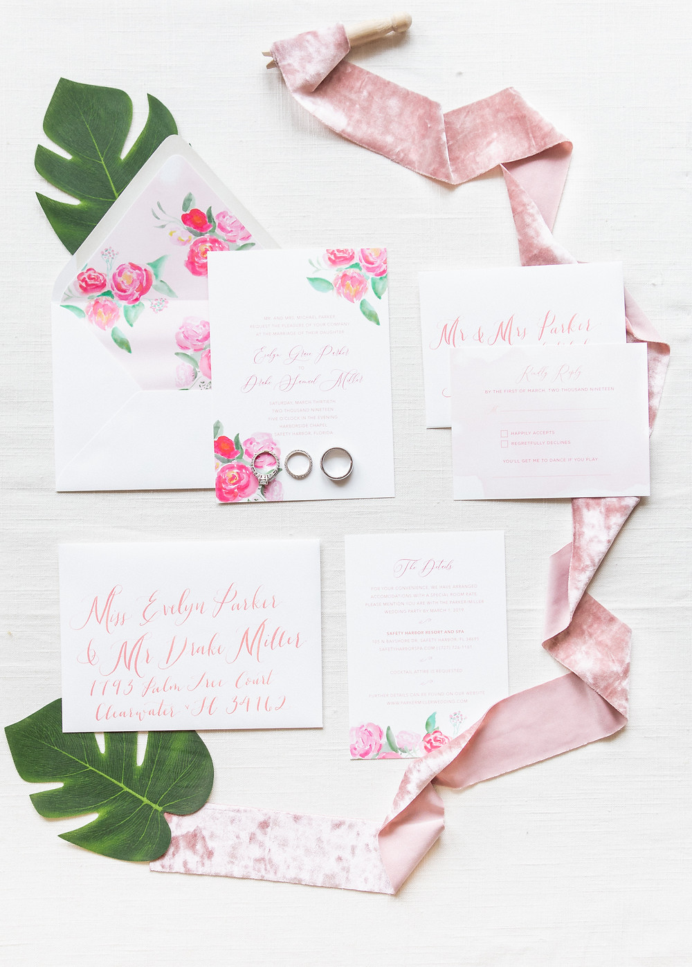 Gorgeous custom wedding invitation suite with pink, tropical watercolor florals.