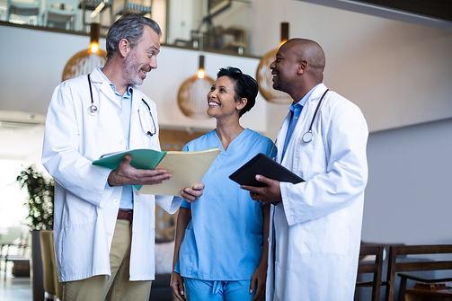 surgeons-and-nurse-discussing-reports-MMRFEMD.jpg