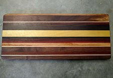 Charcuterie / Serving Board made of assorted hardwoods.