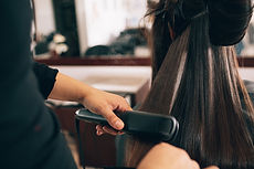 Woman Straightening Hair Styling
