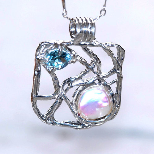 Lava Line Blue Topaz and white freshwater coin pendant