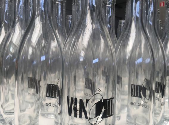 Signa prints on glass bottle.jpg