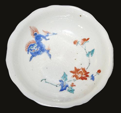 Kakiemon, Arita kiln, Nigoshide bowl enamelled with frolicking shi-shi, c1690