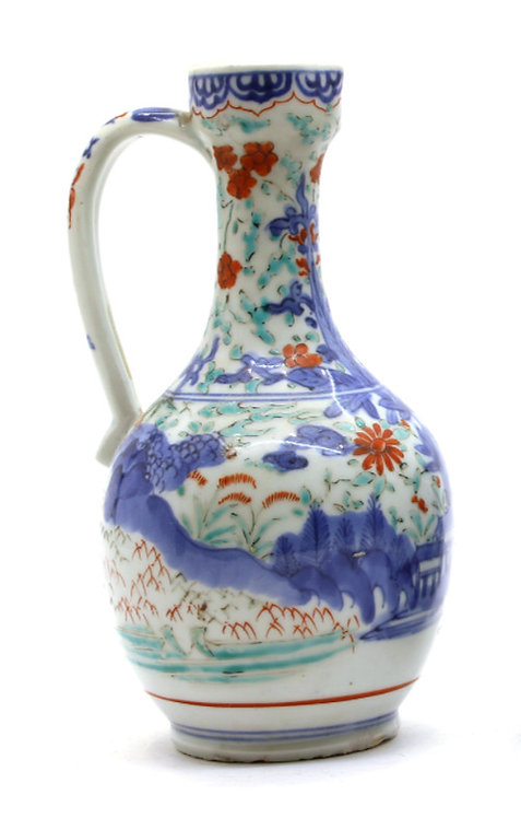 A pair of 17th C Japanese Arita ewers decorated in the Kakiemon style, c1660-80