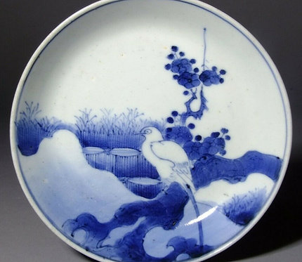 A 17th C Japanese Arita Ai Kutani dish finely painted with Shima Enaga c1660-70