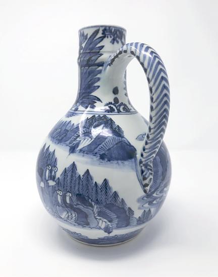 A striking 17th C Japanese Arita export jug, German stoneware form, c1665
