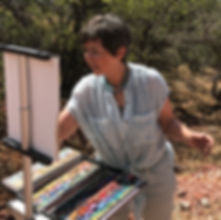 artist lindy cook severns with plein air easel and pastels