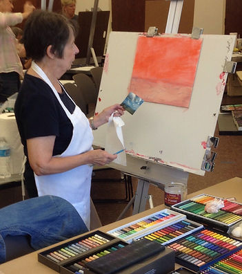 artist joyce runyan at easel with paints