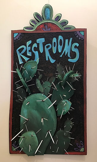 restrooms carved sign with cactus spines by ginger lemons