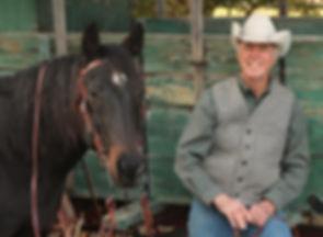 horse and wagon with cowboy artist wayne baize