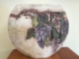 wisteria vine on large pottery vase john davis pottery