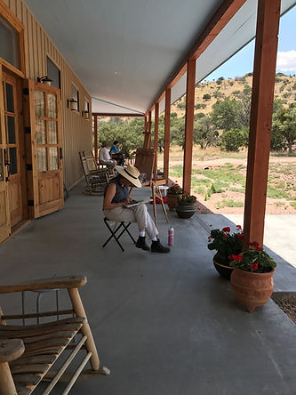 artists painting on gallery porch