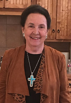 lady with turquoise cross roxa robison old spanish trail gallery