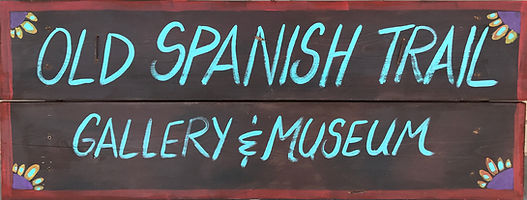 old spanish trail gallery and museum wooden sign