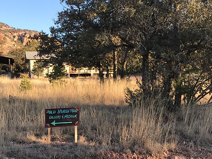 old spanish trail gallery and museum sign and studio in trees at crows nest ranch ft davis