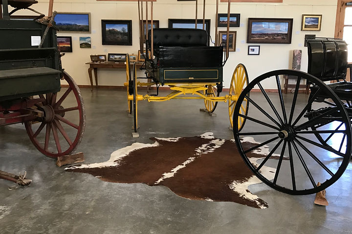 historic ranch wagons and cowhide in art gallery at crows nest ranch davis mts gallery