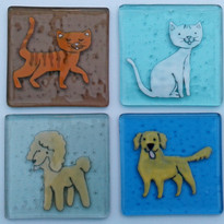 Playful dog and cat coasters