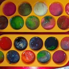 Melting crayons!! Emojis in the making.j