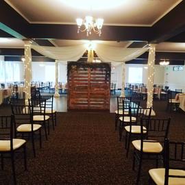 Indoor ceremony with ceiling drape.jpg